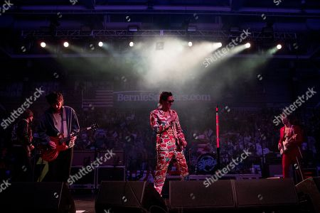 Julian Casablancas, lead singer of The Strokes, center, performs after Democratic presidential candidate Sen. Bernie Sanders, I-Vt., speaks at a campaign stop at the Whittemore Center Arena at the University of New Hampshire, in Durham, N.H