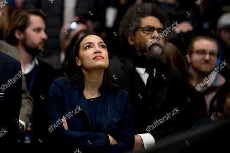 Alexandria Ocasio-Cortez, Cornel West. Rep. Alexandria Ocasio-Cortez, D-N.Y., left, and Harvard Professor Cornel West, right, stand off stage and watch Democratic presidential candidate Sen. Bernie Sanders, I-Vt., speak at a campaign stop at the Whittemore Center Arena at the University of New Hampshire, in Durham, N.H