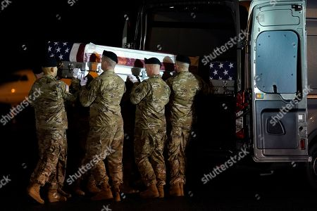 Donald Trump. A U.S. Army carry team moves a transfer case containing the remains of Sgt. 1st Class Antonio Rodriguez, of Las Cruces, N.M., at Dover Air Force Base, Del. According to the Department of Defense both Rodriquez and Sgt. 1st Class Javier Gutierrez, of San Antonio, Texas, died Saturday, Feb. 8, during combat operations in Afghanistan