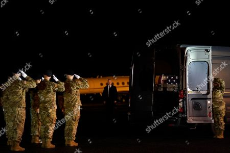 Donald Trump. A U.S. Army carry team salutes after moving transfer case containing the remains of Sgt. 1st Class Javier Gutierrez, of San Antonio, Texas, and Sgt. 1st Class Antonio Rodriguez, of Las Cruces, N.M., at Dover Air Force Base, Del. According to the Department of Defense both died Saturday, Feb. 8, during combat operations in Afghanistan
