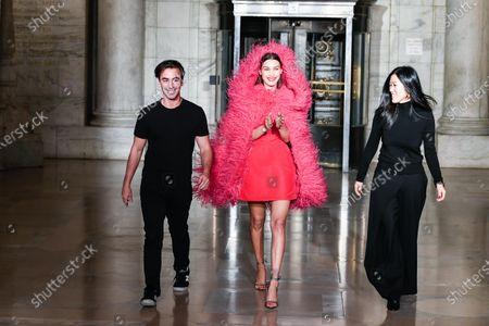 Fernando Garcia, Bella Hadid and Laura Kim on the catwalk