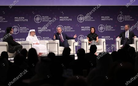 (L-R) John Defterios, Emerging Markets Editor and Anchor of CNN, His Excellency Waleed Al Mokarrab Al Muhairi, Deputy Group CEO & Chief Executive Officer of Mubadala Investment Company, Raymond Dalio, Chairman and Co-Chief Investment Officer at Bridgewater Associates, Dina Powell, Goldman Sachs partner and former advisor to the Trump administration, and Adam Boehler, CEO of US International Development Finance Corporation, speak during the 2020 Milken Institute Middle East and Africa Summit (MEA) at St. Regis Saadiyat Island Resort in Abu Dhabi, United Arab Emirates, 11 February 2020. The summit brings together interdisciplinary thought leaders and decision-makers to discuss the world's most pressing challenges. The event runs on 11-12 February 2020.
