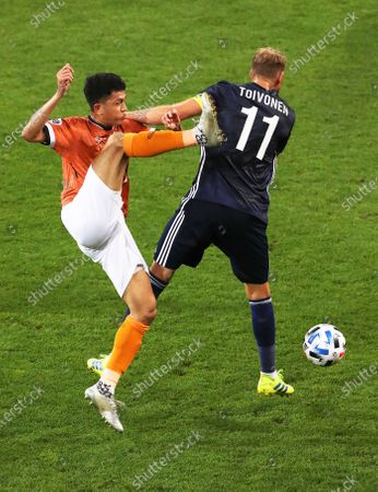 Piyaphon Phanitchakun (L) of Chiangrai United in action against Ola Toivonen (R) of Melbourne Victory during the AFC Champions League match between Melbourne Victory and Chiangrai United at AAMI Stadium in Melbourne, Australia, 11 February 2020.