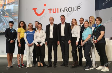 The CEO of German TUI Group Friedrich Joussen (6-R) and the chairman of the TUI supervisory board Dieter Zetsche (6-L) before the annual general meeting of TUI Group in Hanover, northern Germany, 11 February 2020. TUI stock has lost about 20 percent during the last quarter.