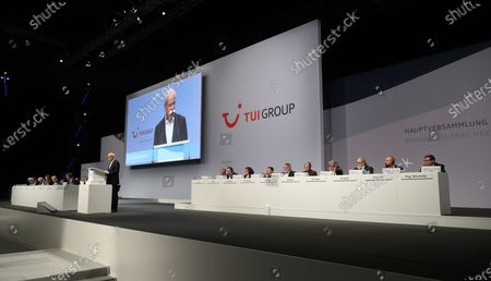 The chairman of the supervisory board of German TUI Group Dieter Zetsche (L) speaks during the annual general meeting of TUI Group in Hanover, northern Germany, 11 February 2020. TUI stock has lost about 20 percent during the last quarter.