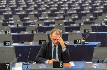 Stock Photo of Philippe Lamberts from the Group of the Greens/European Free Alliance waits for a debate on the 'Proposed mandate for negotiations for a new partnership with the United Kingdom of Great Britain and Northern Ireland' during a plenary session of the European Parliament in Strasbourg, France, 11 February 2020.