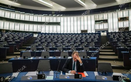 Stock Image of Philippe Lamberts from the Group of the Greens/European Free Alliance waits for a debate on the 'Proposed mandate for negotiations for a new partnership with the United Kingdom of Great Britain and Northern Ireland' during a plenary session of the European Parliament in Strasbourg, France, 11 February 2020.