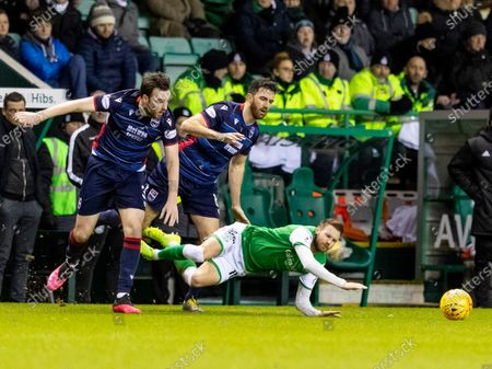 12th February 2020; Easter Road, Edinburgh, Scotland; Scottish Premiership Football, Hibernian versus Ross County; Martin Boyle of Hibernian is fouled by Sean Kelly of Ross County  and Lee Erwin of Ross County