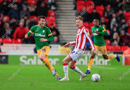 12th February 2020, Bet365 Stadium, Stoke-on-Trent, England; Sky Bet Championship, Stoke City v Preston North End : David Nugent (35) of Preston North End passes the ball beyond Sam Clucas (22) of Stoke City