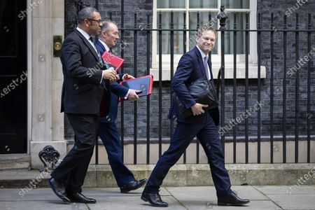 Secretary of State for Transport Grant Shapps (R), Secretary of State for Wales Simon Hart (C) and Minister without Portfolio James Cleverly leave 10 Downing Street after a Cabinet meeting. The Prime Minister announced that the HS2 rail project will go ahead.