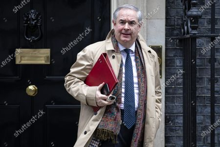 Stock Image of Attorney General Geoffrey Cox leaves 10 Downing Street after a Cabinet meeting. The Prime Minister has announced that the HS2 rail project will go ahead.