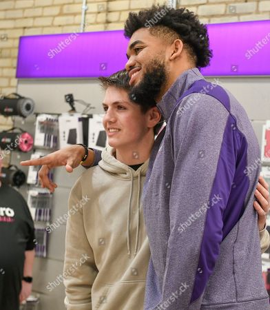 Stock Photo of Karl-Anthony Towns surprises unsuspecting customers as an employee at a Metro by T-Mobile store on in Minneapolis. Karl-Anthony Towns made the appearance to help announce his partnership as part of Metro's new #RuleYourDay campaign