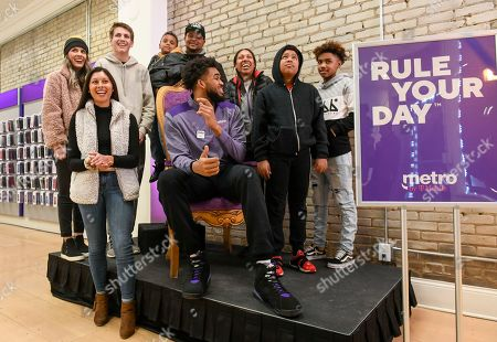Stock Picture of Karl-Anthony Towns surprises unsuspecting customers as an employee at a Metro by T-Mobile store on in Minneapolis. Karl-Anthony Towns made the appearance to help announce his partnership as part of Metro's new #RuleYourDay campaign