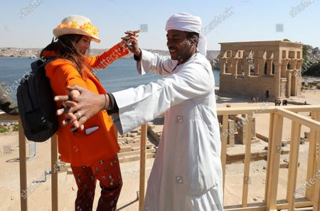 Victoria Abril dances with a Nubian man as she visits Temple of Philae, Aswan, Egypt, 11 February 2020.  Abril is visiting Aswan to participate in the Aswan International Women Film Festival, running from 10 to 15 February.
