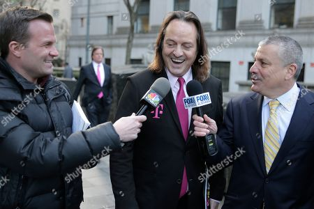 T-Mobile chief executive John Legere speaks to reporters as he leaves the courthouse in New York. A federal judge has removed a major obstacle to T-Mobile's $26.5 billion takeover of Sprint, as he rejected claims by a group of states that the deal would mean less competition and higher phone bills