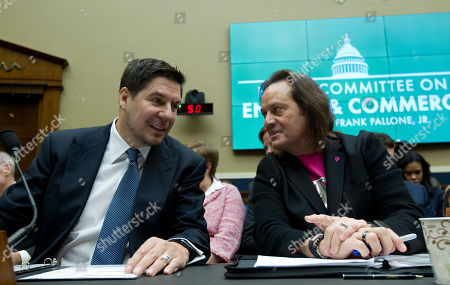 Sprint Corporation Executive Chairman Marcelo Claure, left, speaks with T-Mobile US CEO and President John Legere during the House Commerce subcommittee hearing on Capitol Hill in Washington. A federal judge has removed a major obstacle to T-Mobile's $26.5 billion takeover of Sprint, as he rejected claims by a group of states that the deal would mean less competition and higher phone bills
