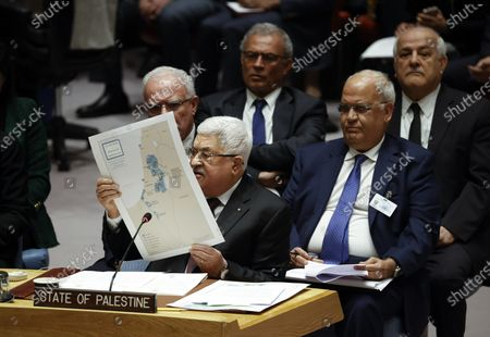 President of the State of Palestine Mahmoud Abbas (C) holds up a map as he addresses the UN Security Council about the situation in the Middle East, including the Palestinian question at United Nations headquarters in New York, New York, USA, 11 February 2020.