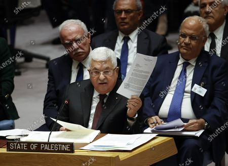 President of the State of Palestine Mahmoud Abbas (C) holds up a letter from the United States Congress as he addresses the UN Security Council about the situation in the Middle East, including the Palestinian question at United Nations headquarters in New York, New York, USA, 11 February 2020.
