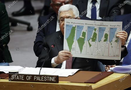 President of the State of Palestine Mahmoud Abbas (C) holds up a map of Palestine in 1917, 1937, 1947, 1967 and 2020 as he addresses the UN Security Council about the situation in the Middle East, including the Palestinian question at United Nations headquarters in New York, New York, USA, 11 February 2020.
