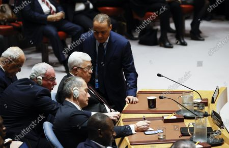 Mahmoud Abbas (C), President of the State of Palestine listens alongside his delegation after he addressed the Security Council about the situation in the Middle East, including the Palestinian question at United Nations headquarters in New York, New York, USA, 11 February 2020.