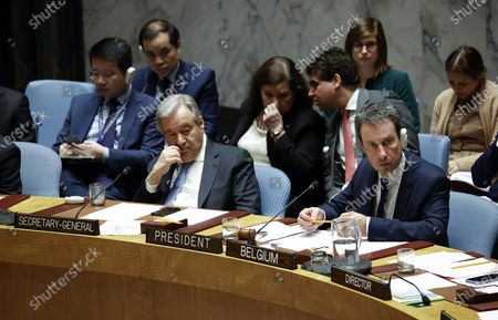 Philippe Goffin, Foreign Minister of Belgium and current President of Security Council (R) listens alongside United Nations Secretary General Antonio Guterres (L) as Mahmoud Abbas, President of the State of Palestine addresses the Security Council about the situation in the Middle East, including the Palestinian question at United Nations headquarters in New York, New York, USA, 11 February 2020.