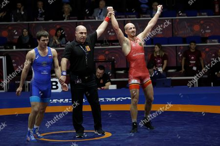 Germany's Frank Staebler, right, celebrates after winning against Russia's Adam Kurak, left, during the semi-final of the 72Kg category of the men's Greco-Roman wrestling at the European Wrestling Championships in Ostia, Italy
