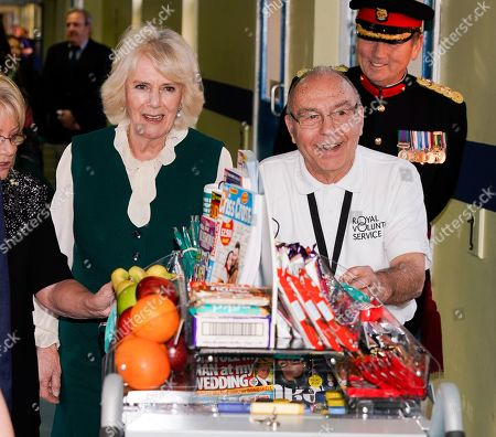 Camilla Duchess of Cornwall pushing the trolley in Leicester's General hospital with John Thompson (right, glasses). during a visit to Leicester General Hospital to launch the Big Trolley Push campaign.