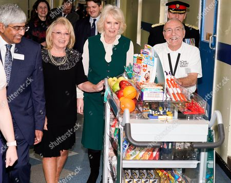 Elaine Paige OBE (left, black) and Camilla Duchess of Cornwall pushing the trolley in Leicester's General hospital with John Thompson (right, glasses). during a visit to Leicester General Hospital to launch the Big Trolley Push campaign.