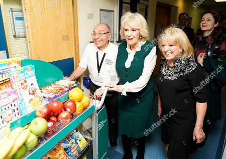 Elaine Paige OBE (right, black) and Camilla Duchess of Cornwall pushing the trolley in Leicester's General hospital with John Thompson (left, glasses). during a visit to Leicester General Hospital to launch the Big Trolley Push campaign.