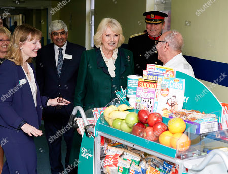 Catherine Johnstone CEO of Royal Voluntary Service (left) and Camilla Duchess of Cornwall pushing the trolley in Leicester's General hospital with John Thompson (right, glasses). during a visit to Leicester General Hospital to launch the Big Trolley Push campaign.