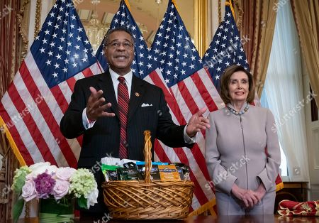 Nancy Pelosi, Emanuel Cleaver. Speaker of the House Nancy Pelosi, D-Calif., right, whose favorite team, the San Francisco 49ers, lost the Super Bowl to the Kansas City Chiefs, represented by Rep. Emanuel Cleaver, D-Mo., pays off a friendly wager of California chocolates and nuts, at the Capitol in Washington