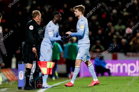 Leeds United forward Jean Kevin Augustin (29), on loan from Red Bull Leipzig, comes on for Leeds United forward Patrick Bamford (9) during the EFL Sky Bet Championship match between Brentford and Leeds United at Griffin Park, London