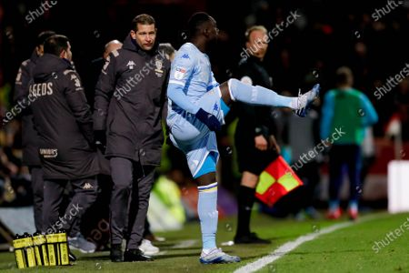 Leeds United forward Jean Kevin Augustin (29), on loan from Red Bull Leipzig, warms up before coming off the bench during the EFL Sky Bet Championship match between Brentford and Leeds United at Griffin Park, London