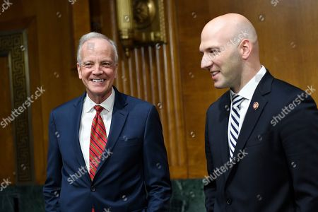 Stock Picture of Anthony Gonzalez, Jerry Moran. Senate Commerce subcommittee chairman Sen. Jerry Moran, R-Kan., left, talks with Rep. Anthony Gonzalez, R-Ohio, right, before the start of a hearing on Capitol Hill in Washington, on intercollegiate athlete compensation
