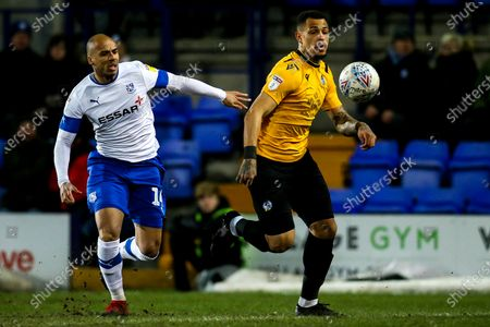 Jonson Clarke-Harris of Bristol Rovers goes past Jake Caprice of Tranmere Rovers