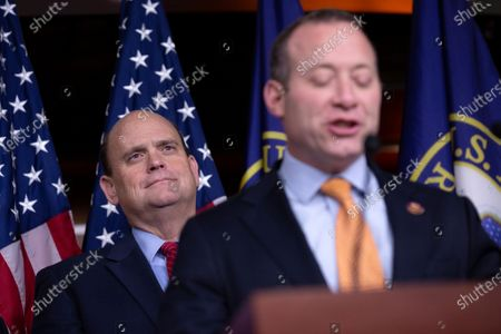 Stock Picture of United States Representative Tom Reed (Republican of New York) listens as United States Representative Josh Gottheimer (Democrat of New Jersey) delivers remarks during a news conference regarding legislative goals for the upcoming year at the United States Capitol.