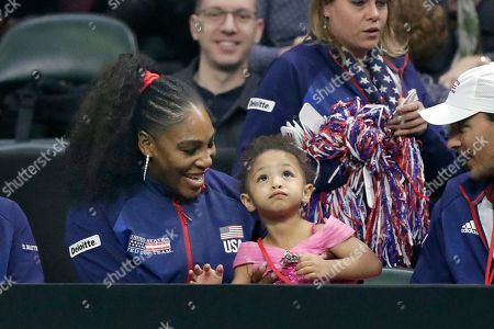 United States' Serena Williams sits with her daughter, Alexis Olympia Ohanian Jr., as they look on during a Fed Cup qualifying tennis match, in Everett, Wash
