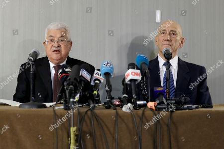Mahmoud Abbas, Ehud Olmert. Palestinian President Mahmoud Abbas, left, speaks while former Israeli Prime Minister Ehud Olmert listens during a news conference in New York