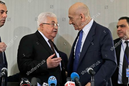 Mahmoud Abbas, Ehud Olmert. Palestinian President Mahmoud Abbas, left, speaks with former Israeli Prime Minister Ehud Olmert after a news conference in New York
