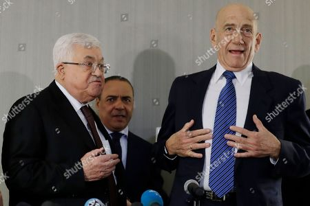 Mahmoud Abbas, Ehud Olmert. Palestinian President Mahmoud Abbas, left, and former Israeli Prime Minister Ehud Olmert, right, stand up at the end of a news conference in New York