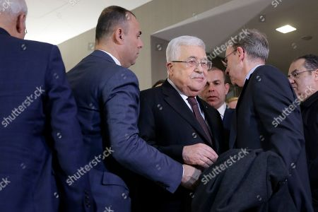 Palestinian President Mahmoud Abbas, center, leaves a news conference with former Israeli Prime Minister Ehud Olmert in New York