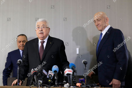 Mahmoud Abbas, Ehud Olmert. Palestinian President Mahmoud Abbas, center, and former Israeli Prime Minister Ehud Olmert, right, arrive for a news conference in New York
