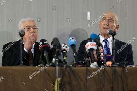 Mahmoud Abbas, Ehud Olmert. Palestinian President Mahmoud Abbas, left, listens while former Israeli Prime Minister Ehud Olmert speaks during a news conference in New York