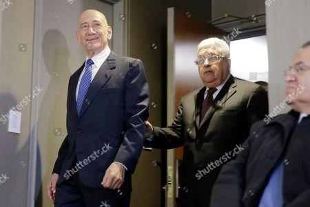 Mahmoud Abbas, Ehud Olmert. Palestinian President Mahmoud Abbas, center, and former Israeli Prime Minister Ehud Olmert, left, arrive for a news conference in New York