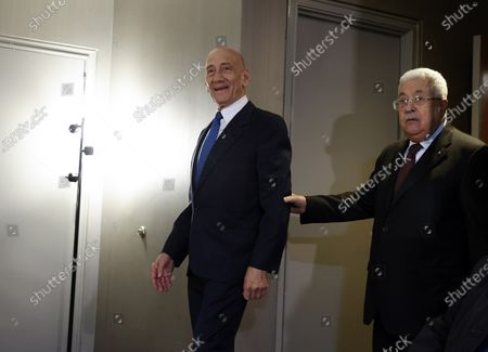 Former Israeli Prime Minister Ehud Olmert (L) and Palestinian President Mahmoud Abbas (R) enter to attend a joint press conference at the Grand Hyatt Hotel in New York, New York, USA, 11 February 2020.