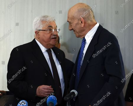 Former Israeli Prime Minister Ehud Olmert (R) and Palestinian President Mahmoud Abbas (L) talk after a joint press conference at the Grand Hyatt Hotel in New York, New York, USA, 11 February 2020.