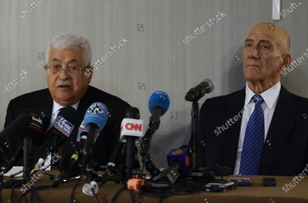 Former Israeli Prime Minister Ehud Olmert (R) and Palestinian President Mahmoud Abbas (L) hold a joint press conference at the Grand Hyatt Hotel in New York, New York, USA, 11 February 2020.