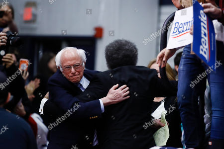 Democratic presidential candidate Sen. Bernie Sanders, I-Vt., and Cornel West embrace before Sanders speaks to supporters at a primary night election rally in Manchester, N.H
