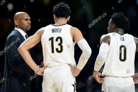 NAMES. Vanderbilt head coach Jerry Stackhouse talks with Vanderbilt forward Matthew Moyer (13) and guard Saben Lee (0) during the second half of an NCAA college basketball game against Kentucky, in Nashville, Tenn. Kentucky won 78-64
