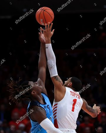 Jermaine Harris, Obi Toppin. Rhode Island's Jermaine Harris (0) battles for the ball against Dayton's Obi Toppin (1) for the opening tip-off in the first half of an NCAA college basketball game, in Dayton, Ohio. Dayton won 81-67